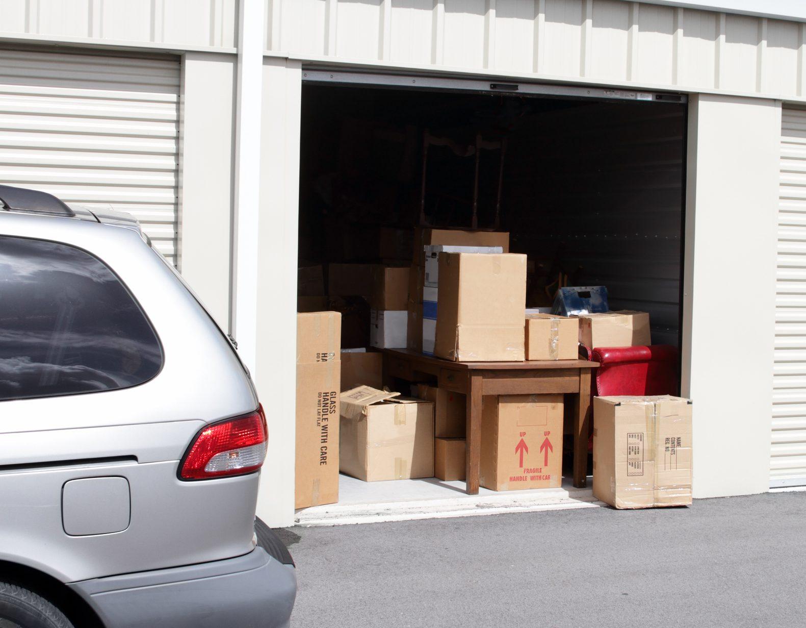 minivan parked outside storage unit
