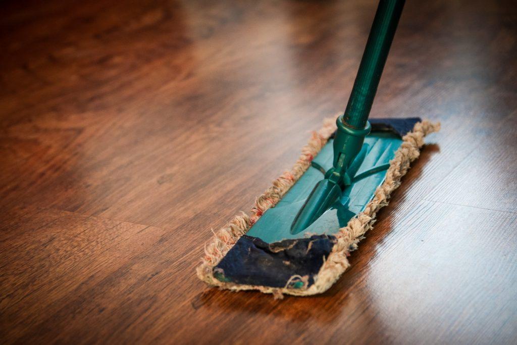 Dusting a wooden floor